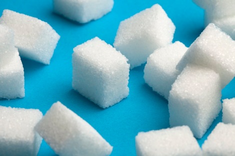 Sugar cubes with one standing out in the middle